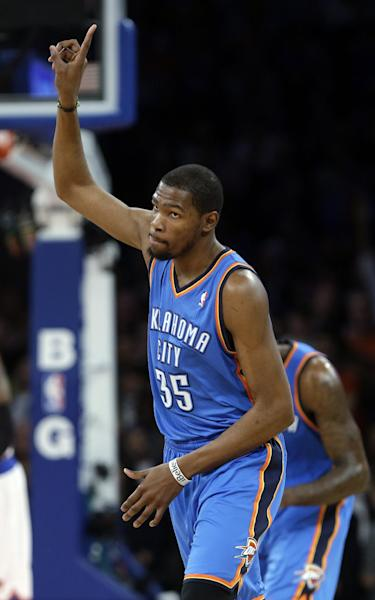 Oklahoma City Thunder's Kevin Durant (35) reacts after scoring during the first half of an NBA basketball game against the New York Knicks Thursday, March 7, 2013, in New York. (AP Photo/Frank Franklin II)