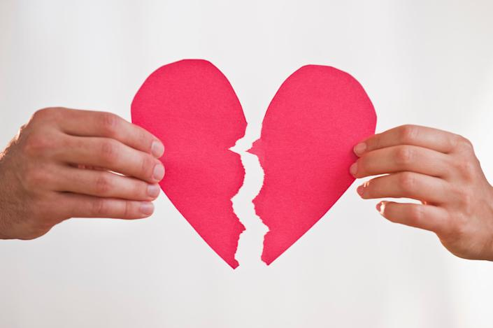 Dividing debt during a breakup comes down to the nature of your relationship and the state where you live. (Photo: Tetra Images via Getty Images)