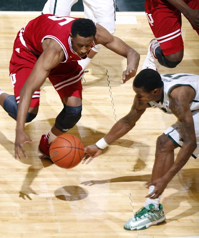 Michigan State's Keith Appling, right, and Indiana's Troy Williams (5) vie for a loose ball during the first half of an NCAA college basketball game, Tuesday, Jan. 21, 2014, in East Lansing, Mich. (AP Photo/Al Goldis)