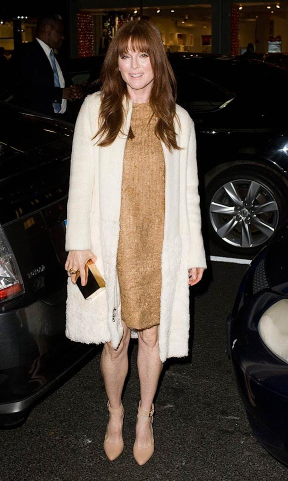 """She might be turning 51 this week, but Julianne Moore still looked red hot as she arrived at the Americans for Marriage Equality event at the Calvin Klein store in New York City on Monday night. Fittingly, the """"Crazy, Stupid, Love"""" star donned a Calvin Klein ensemble -- an above-the-knee gold dress and plush cream coat -- and left her signature red dresses down to complete her sexy look. (11/28/2011)"""