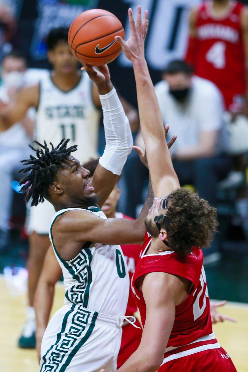 Michigan State forward Aaron Henry (0) is blocked by Indiana forward Race Thompson (25) in the first half against Indiana on Tuesday, March 2, 2021, in East Lansing.