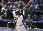 Colorado Rockies' Nolan Arenado connects for a solo home run off Pittsburgh Pirates starting pitcher Steven Brault in the sixth inning of a baseball game Sunday, Sept. 1, 2019, in Denver. (AP Photo/David Zalubowski)