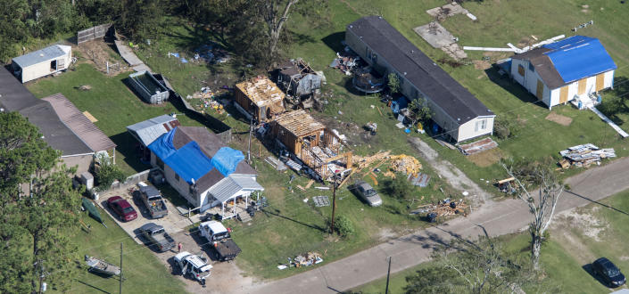Blue tarps cover houses in the aftermath of Hurricane Delta, Saturday Oct. 10, 2020, in Lake Arthur, La. (Bill Feig/The Advocate via AP, Pool)