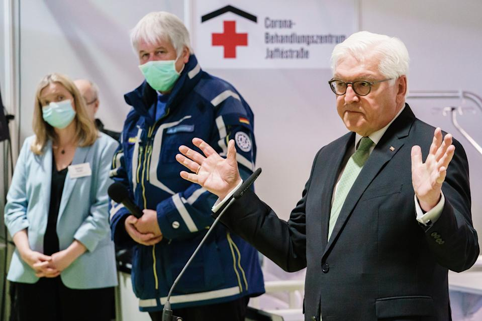 BERLIN, GERMANY - MAY 14: German President Frank-Walter Steinmeier speaks to staff while touring a new, temporary hospital for treating Covid-19 patients during the coronavirus crisis on May 14, 2020 in Berlin, Germany. The new hospital, which was completed earlier this week, occupies Hall 26 of the Berliner Messe trade fair grounds and has the capacity to treat up to 500 people. So far 6,300 people in Berlin have been confirmed to have been infected with the virus and 170 have died. The rate of infections in Berlin has dropped to only a handful of new cases per day. (Photo by Clemens Bilal-Pool/Getty Images)