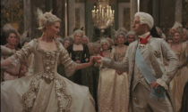 """<p>When Sofia Coppola set out to re-create the French aristocratic court of King Louis XVI and Marie Antoinette, she tapped Hollywood costume designer Milena Canonero to imagine the wardrobe of the controversial queen. Canonero, who won an <a href=""""https://www.area-arch.it/en/marie-antoinette-theoscarwinningcostumesofaqueen/"""" rel=""""nofollow noopener"""" target=""""_blank"""" data-ylk=""""slk:Oscar for her work"""" class=""""link rapid-noclick-resp"""">Oscar for her work</a>, amused the audience with a new extravagant ensemble in every scene—but none is more iconic than Marie Antoinette's opulent ball gown in this scene. </p>"""
