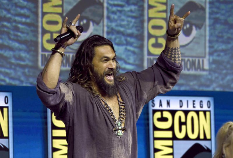 "Jason Momoa greets the crowd at the Warner Bros. Theatrical panel for ""Aquaman"" on day three of Comic-Con International on Saturday, July 21, 2018, in San Diego. (Photo by Chris Pizzello/Invision/AP)"
