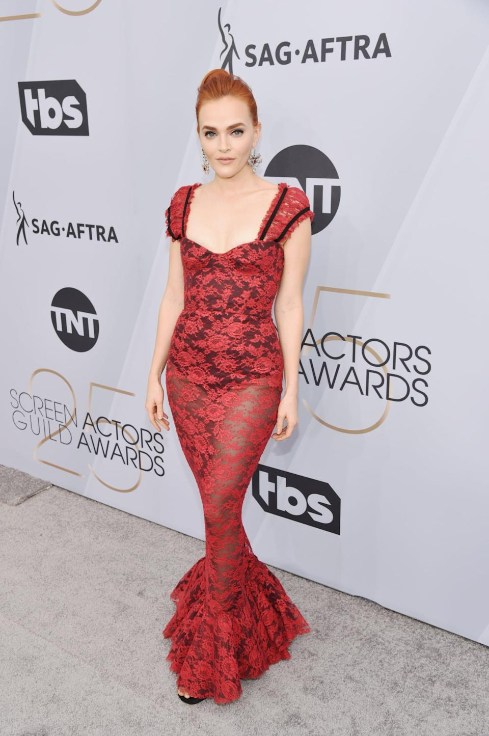 <p>Wearing a sheer Brock Collection gown.</p>