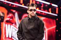 <p>Bad Bunny gets into the ring during Monday's episode of WWE show <em>Monday Night Raw</em>.</p>