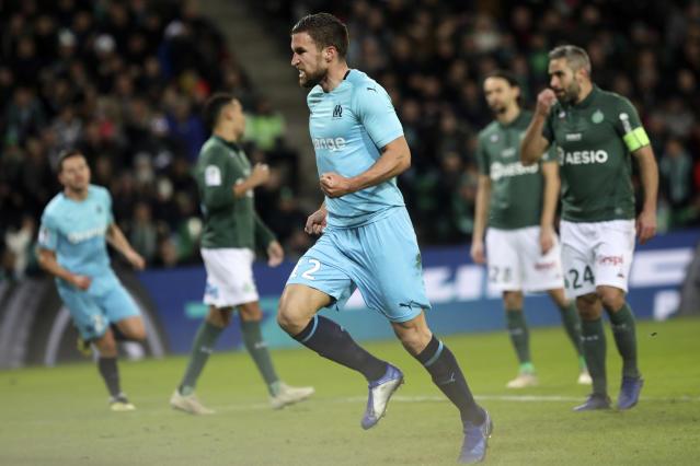 Marseillle's Kevin Strootman celebrates after he scored a goal against Saint-Etienne during their French League One soccer match in Saint-Etienne, central France, Wednesday, Jan. 16, 2019. (AP Photo/Laurent Cipriani)