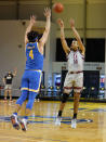 Stanford forward Spencer Jones (14) takes a three-point shot over UCLA guard Jaime Jaquez Jr. (4) during the first half of an NCAA college basketball game in Santa Cruz, Calif., Saturday, Jan. 23, 2021. (AP Photo/Tony Avelar)