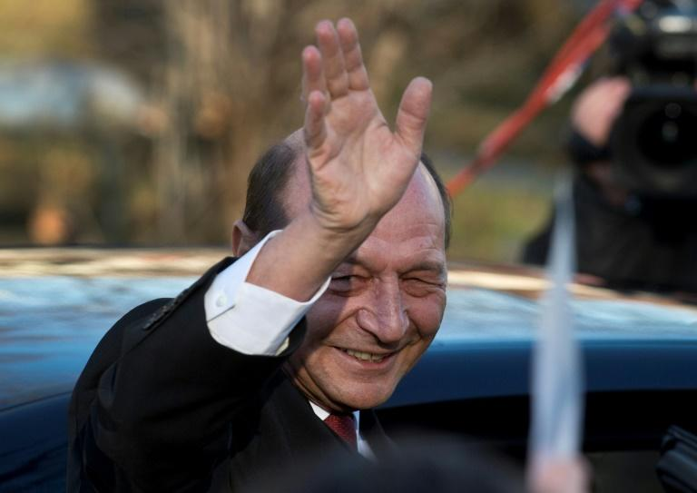 Former president Traian Basescu, seen at a 2014 inauguration ceremony for his successor Klaus Iohannis, said he would appeal against the court finding that he collaborated with Communist-era secret police