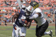 Auburn running back Sean Jackson (44) caries the ball in for a touchdown as Alabama State lineman Joshua Long (98) defends during the second half of an NCAA football game Saturday, Sept. 11, 2021, in Auburn, Ala. (AP Photo/Butch Dill)