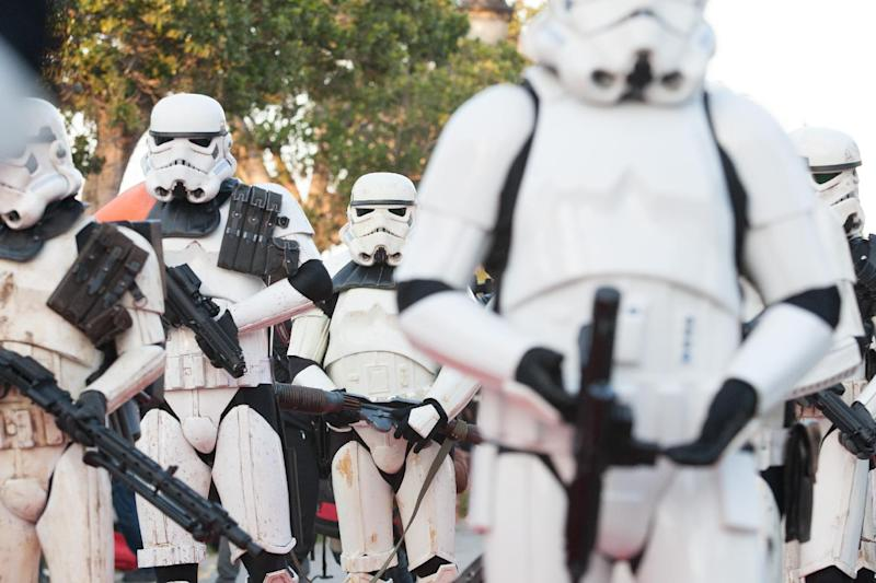 "Star Wars fan dressed as stormtroopers parade along Tunis' stately, tree-lined Bourguiba Avenue, in Tunisia, Wednesday, April 30, 2014. The empire was not striking back against the poster child for Arab democracy — just an innovative campaign to encourage tourists to return to this sunny desert-and-beach nation in North Africa. ""We came here to Tunis to help save the Star Wars sites in Matmata and Tozeur and convince people to return to Tunisia,"" said Ingo Kaiser, head of a Star Wars fan club in Europe, referring to the movie sets that are slowly being covered up by sand in the Tunisian desert. (AP Photo/Aimen Zine)"