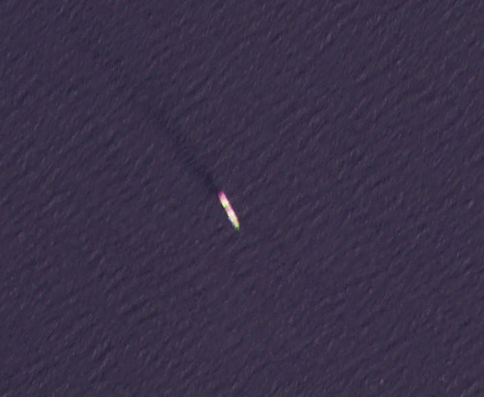 This Wednesday, April 7, 2021, satellite photo by Planet Labs Inc. shows the MV Saviz in the Red Sea as it leaks oil. An attack Tuesday on the Iranian cargo ship said to serve as a floating base for its paramilitary Revolutionary Guard off Yemen has escalated a yearslong shadow war on Mideast waters, just as world powers negotiate over Tehran's tattered nuclear deal. (Nournews via AP)(Planet Labs Inc. via AP)