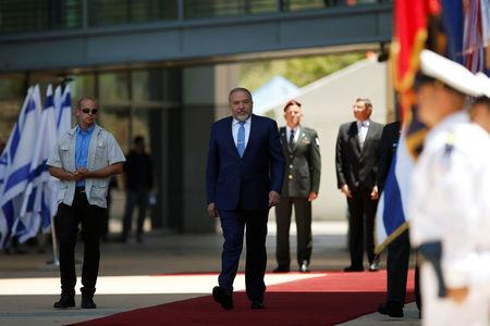 Lieberman reviews an honour guard during a welcoming ceremony at the Defence Ministry in Tel Aviv, Israel