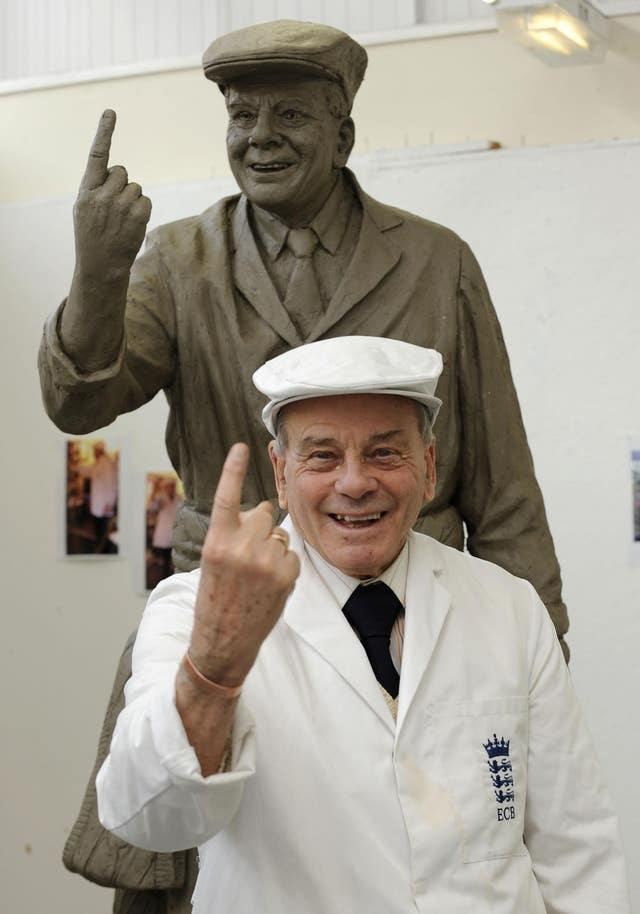 Dickie Bird with a cast of the sculpture that was erected of him in Barnsley