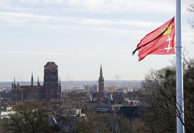 The flag of the city of Gdansk flies at half-staff over Gdansk, Poland, Tuesday, Jan. 15, 2019. Flags flew at half-staff and people signed condolence books at municipal buildings across Poland and in diplomatic missions abroad on Tuesday as the nation mourned the stabbing death of the popular liberal mayor of Gdansk. (AP Photo/Wojciech Strozyk)