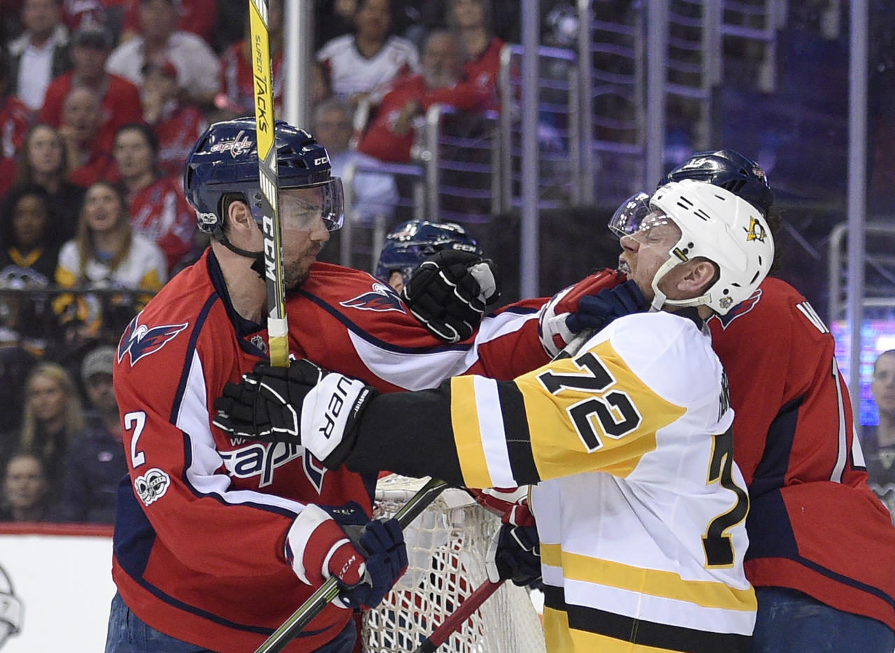 Washington Capitals defenseman Matt Niskanen (2) scuffles with Pittsburgh Penguins right wing Patric Hornqvist (72), of Sweden, during the first period of Game 1 in an NHL Stanley Cup hockey second-round playoff series, Thursday, April 27, 2017, in Washington. (AP Photo/Nick Wass)