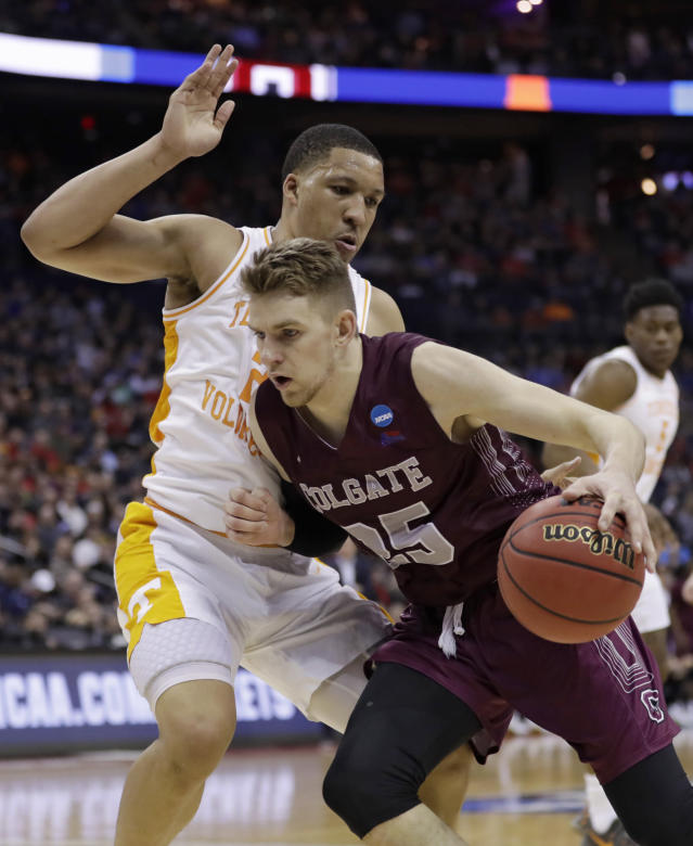 Colgate's Rapolas Ivanauskas, right, drives past Tennessee's Grant Williams in the first half of a first-round game in the NCAA mens college basketball tournament in Columbus, Ohio, Friday, March 22, 2019. (AP Photo/Tony Dejak)