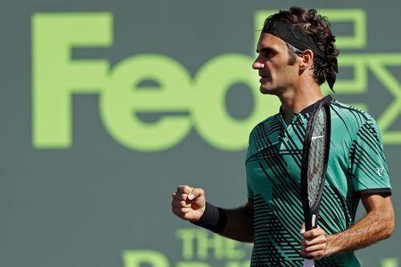 Mar 27, 2017; Miami, FL, USA; Roger Federer of Switzerland celebrates after winning match point against Juan Martin del Potro of Argentina (not pictured) on day seven of the 2017 Miami Open at Crandon Park Tennis Center. Mandatory Credit: Geoff Burke-USA TODAY Sports