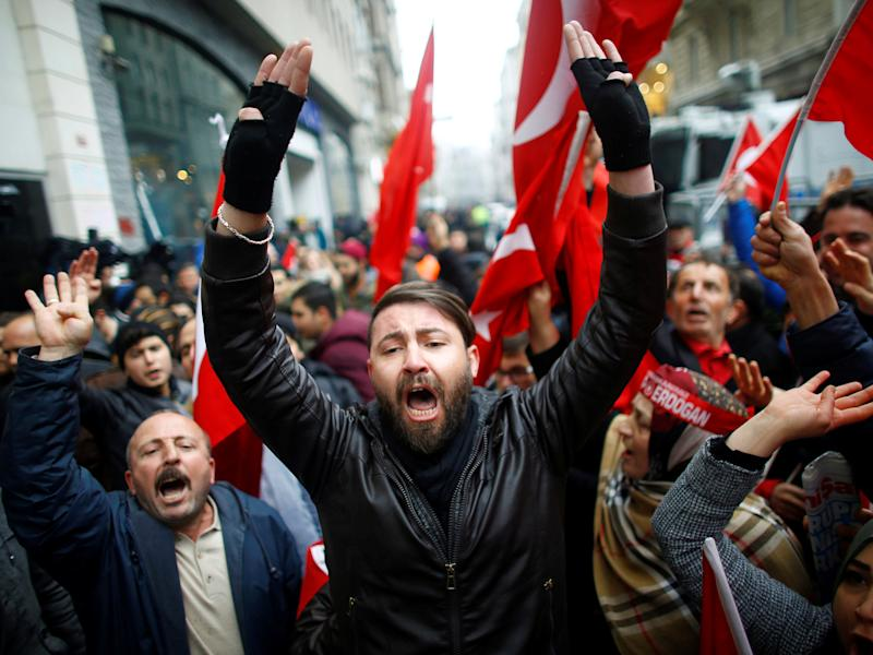 Turkish supporters of President Erdogan protest outside the Dutch Consulate in Istanbul: Reuters