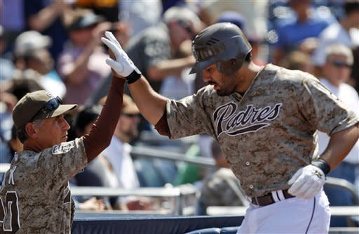 San Diego Padres' Carlos Quentin, right, high-fives with manager Bud Black after his seventh-inning home run against the New York Mets during a baseball game on Sunday, Aug. 5, 2012, in San Diego. (AP Photo/Lenny Ignelzi)