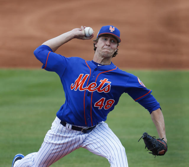 New York Mets starting pitcher Jacob deGrom (48) works in the first inning of a spring training baseball game against the Houston Astros Sunday, March 11, 2018, in Port St. Lucie, Fla. (AP Photo/John Bazemore)