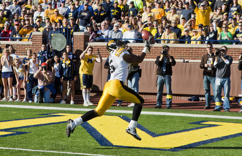 Iowa wide receiver Derrell Johnson-Koulianos (15) catches a 31-yard touchdown in the first second quarter of an NCAA college football game against Michigan, Saturday, Oct. 16, 2010, in Ann Arbor, Mich. (AP Photo/Tony Ding)