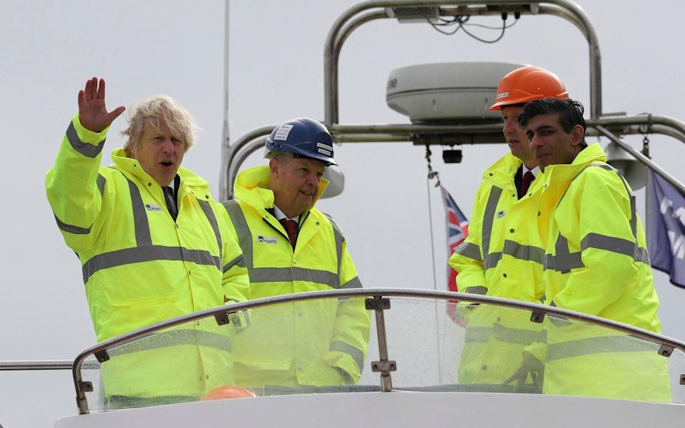 Prime Minister Boris Johnson (left) and Chancellor Rishi Sunak (right) on a visit to Teesside, one of England's eight new freeports, in March - AP Photo/Scott Heppell