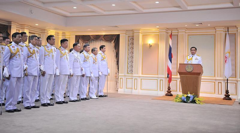 Photograph released by Government House and taken on August 25, 2014 shows Thai Army Chief Prayut Chan-O-Cha (R) reading a statement after receiving a royal command during a ceremony at the Army headquarters in Bangkok on August 25, 2014 (AFP Photo/)