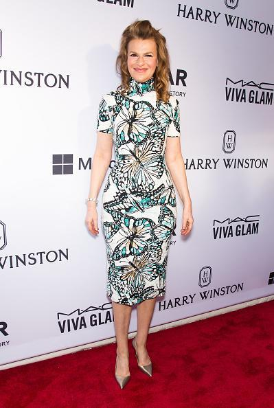 """Sandra Bernhard attended the 2015 amfAR Inspiration Gala New York at Spring Studios with her friend Andy Cohen, who was being honored for his charitable work. """"Andy wasn't ready for his philanthropic work until those Real Houswives,"""" she said as she presented him with the award wearing a Marc Bouwer dress covered in butterflies."""