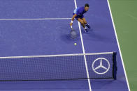 Novak Djokovic, of Serbia, returns a shot to Alexander Zverev, of Germany, during the semifinals of the US Open tennis championships, Friday, Sept. 10, 2021, in New York. (AP Photo/Seth Wenig)