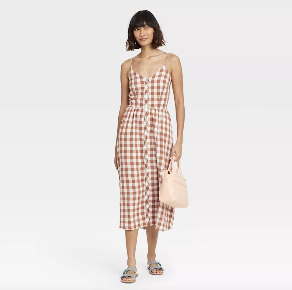 <p>The <span>A New Day Gingham Sleeveless Button-Front Dress</span> ($28) is extremely versatile, and can be worn with slide sandals, sneakers or low-heeled mules.</p>