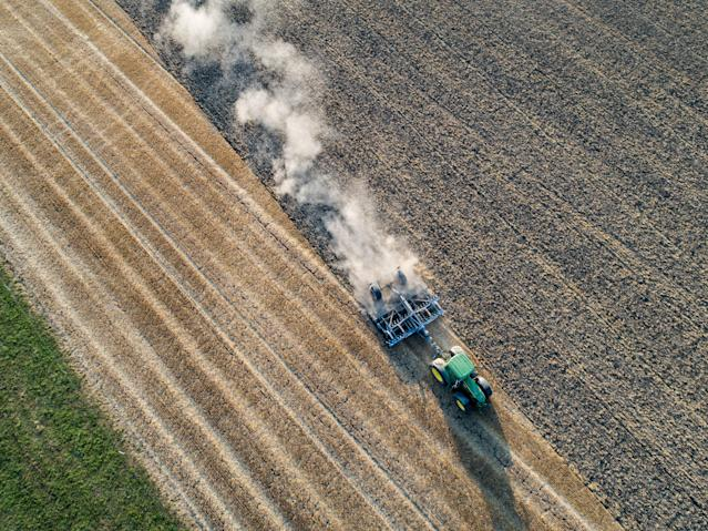 <p>A farmer prepares a wheat field for the next sowing on Aug. 6, 2018 in Biebesheim near Darmstadt, Germany. Farmers are fighting against the long-lasting drought and heat as they are unable to irrigate their fields on a large scale, which is resulting in large crop failures and income for them. (Photo: Thomas Lohnes/Getty Images) </p>