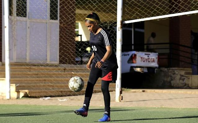 """Sudanese footballerr Rayan Rajab, 22, has played the the game since she was young and says, """"my parents had no objection, they kept telling me to push on with sports"""" (AFP Photo/ASHRAF SHAZLY)"""