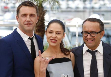 """Cast members Vladimir Vdovichenkov, Elena Lyadova and director Andrey Zvyagintsev pose during a photocall for the film """"Leviathan"""" in competition at the 67th Cannes Film Festival in Cannes"""