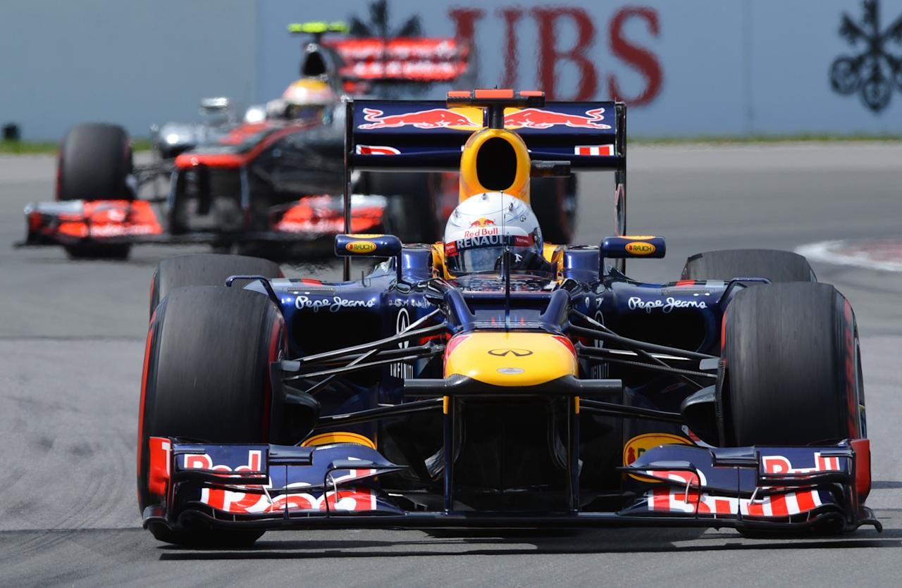 Red Bull Racing driver Sebastian Vettel of Germany leads McLaren Mercedes driver Lewis Hamilton from Great Britain during the Canadian Formula One Grand Prix on June 10, 2012 at the Circuit Gilles Villeneuve in Montreal.    AFP PHOTO/Stan HONDASTAN HONDA/AFP/GettyImages