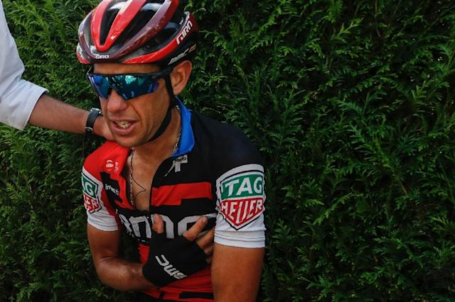 Richie Porte, pictured in July 2018 after crashing in the Tour de France, announced he would withdraw from the World Cycling Championships (AFP Photo/STR)