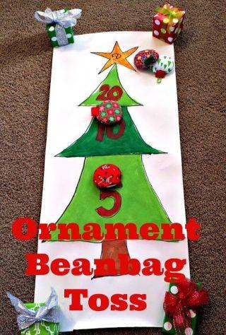 """<p>Amy from <em>Positively Splendid</em> created these bean bags from scratch! If you're not as ambitious (or your sewing skills aren'tup to par), feel free to buy them. The board itself is easy enough to make — wrapping paper or poster board works just fine. Draw a Christmas tree, segmenting it into different point areas. Have your players toss bean bags and log their points. This game is also a perfect opportunity for teams!</p><p><span></span><a rel=""""nofollow"""" href=""""https://ec.yimg.com/ec?url=http%3a%2f%2fwww.positivelysplendid.com%2fornament-bean-bag-toss-game%2f%26quot%3b%26gt%3b%26lt%3bem%26gt%3bSee&t=1508530495&sig=0VvA_a6A8ZHpDB3Ml86Skg--~D more at Positively Splendid»</em></a><span></span><span></span><br></p>"""