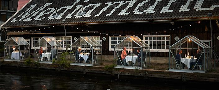"""<div class=""""caption""""> Mediamatic Amsterdam installed a series of mini greenhouses to keep diners safely distanced from other visitors and servers. </div> <cite class=""""credit"""">Photo: Willem Velthoven for Mediamatic Amsterdam</cite>"""
