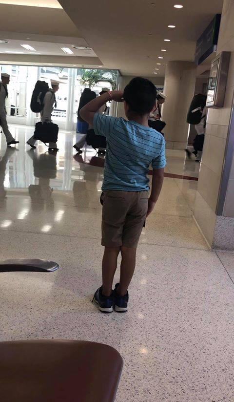 Texas boy salutes U S  Navy members in airport photo