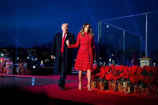 President Donald Trump and first lady Melania Trump held hands at the Christmas tree lighting. (Photo: Getty Images)