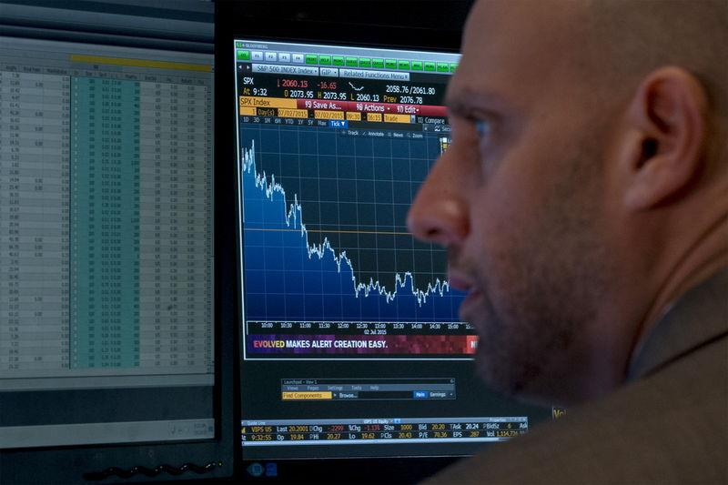 A specialist trader works at his post on the floor of the New York Stock Exchange