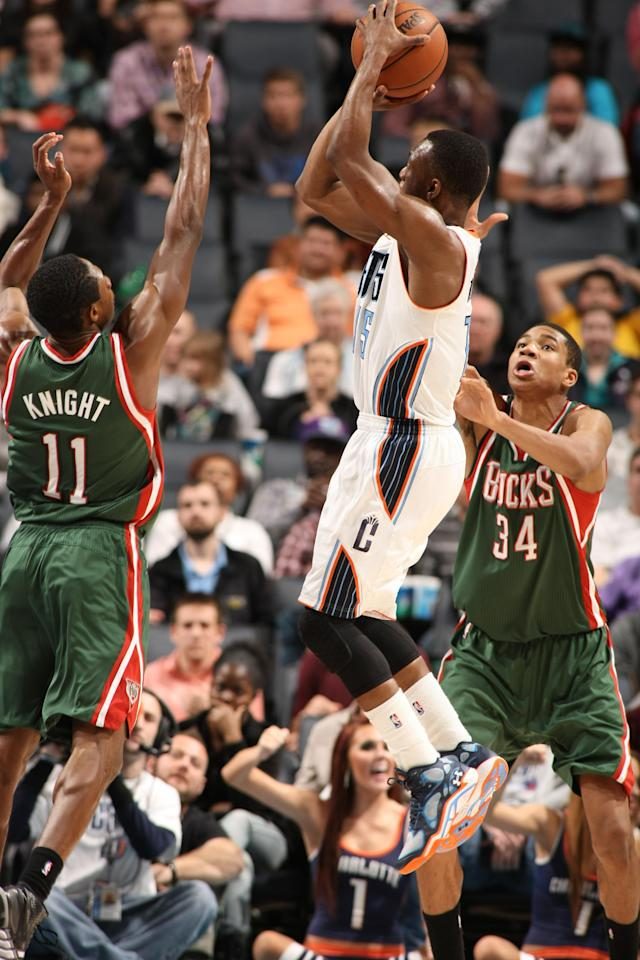 CHARLOTTE, NC - DECEMBER 23: Kemba Walker #15 of the Charlotte Bobcats shoots against the Milwaukee Bucks during the game at the Time Warner Cable Arena on December 23, 2013 in Charlotte, North Carolina. (Photo by Kent Smith/NBAE via Getty Images)
