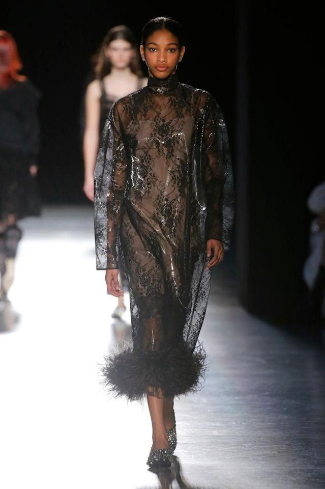 <p>A sheer black dress with feather bottom at the Christopher Kane FW18 show. (Photo: Getty) </p>