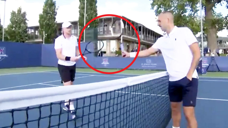 Tennis player Dan Evans (pictured right) reaches out to touch rackets with Kyle Edmund's (pictured left) after their match.