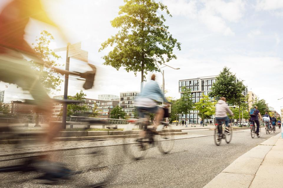 Cyclists riding through a city. Source: Getty Images