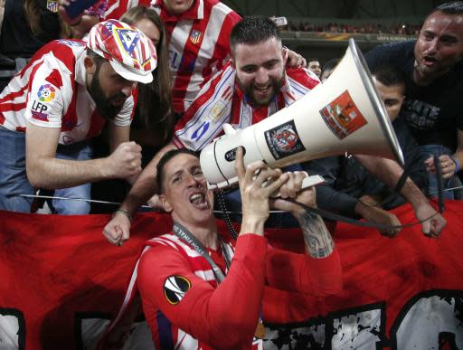 FILE - In this May 16, 2018 file photo, Atletico's Fernando Torres celebrates, surrounded by fans, the 3-0 win of his team after the Europa League Final soccer match between Marseille and Atletico Madrid at the Stade de Lyon in Decines, outside Lyon, France. Former Spain striker Fernando Torres announced on Tuesday July 10, 2018 that he will play for Sagan Tosu in the J1 League, dashing the hopes of Australian football that he might become a marquee attraction for its struggling A-League. (AP Photo/Thibault Camus, File)