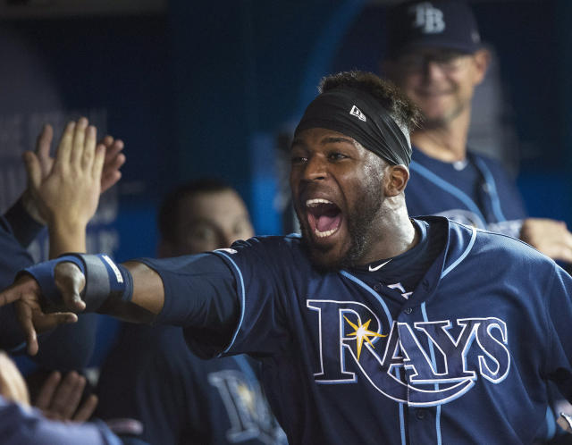 Tampa Bay Rays center fielder Guillermo Heredia (54) celebrates with teammates in the dugout after scoring a run during the third inning of a baseball game against the Toronto Blue Jays, Saturday, July 27, 2019 in Toronto. (Nathan Denette/Canadian Press via AP)
