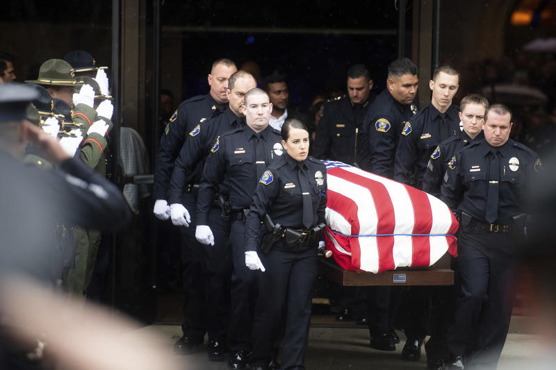 Slain police officer called 'American hero' at his funeral
